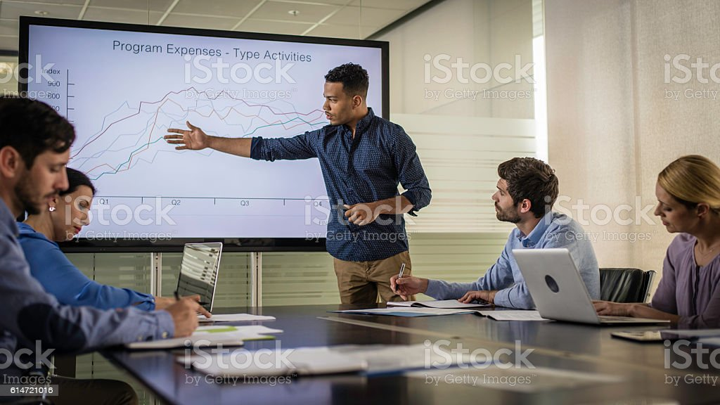 Businessman reporting his company's yearly revenue stock photo