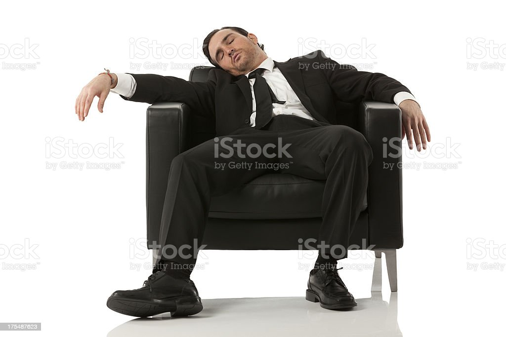 Businessman resting in an armchair stock photo