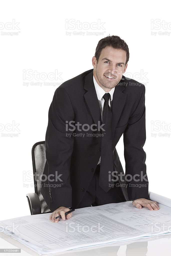 Businessman reviewing a blueprint royalty-free stock photo