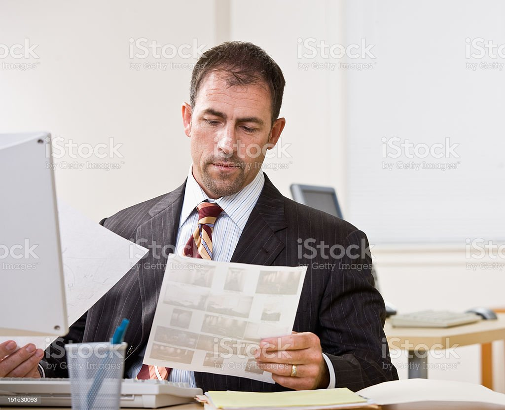 Businessman Reviewing Paperwork royalty-free stock photo