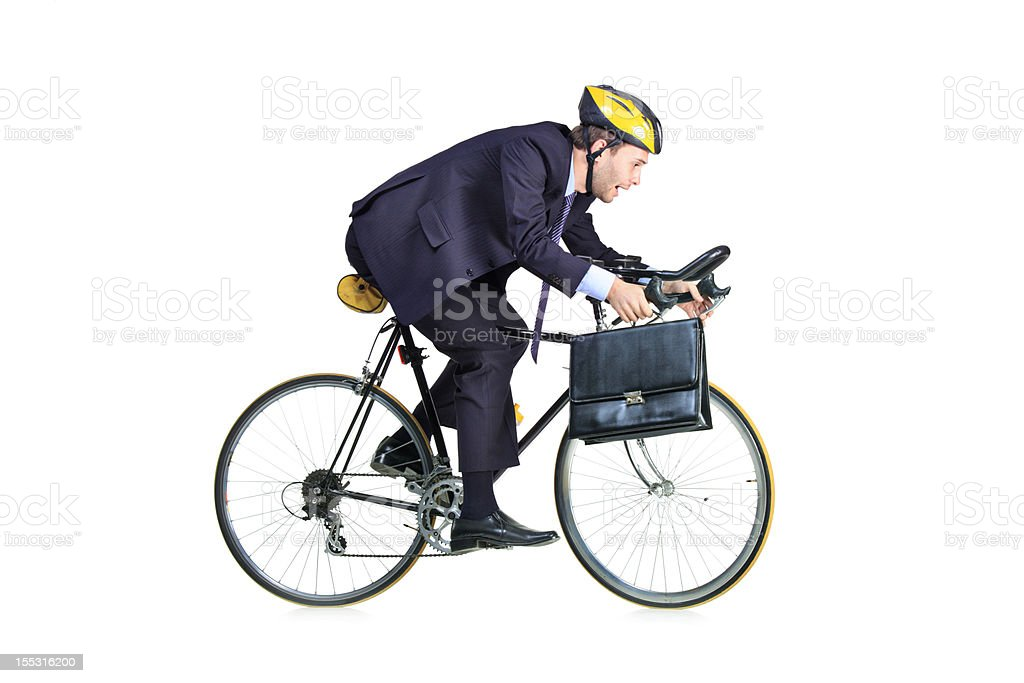 Businessman riding a bicycle royalty-free stock photo