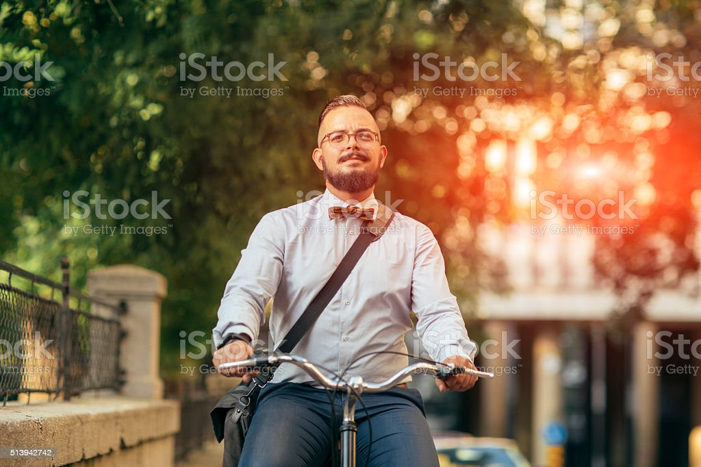 Businessman Riding Bicycle In City. stock photo