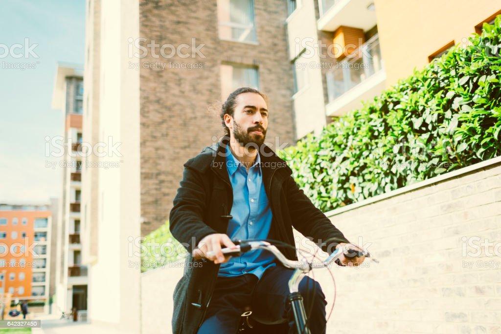 Businessman riding bicycle stock photo