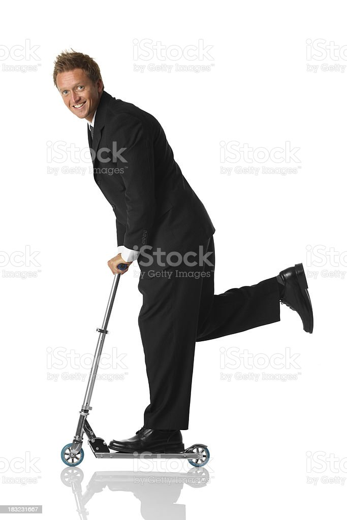 Businessman riding push scooter royalty-free stock photo