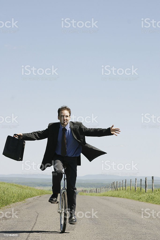 Businessman riding unicycle II royalty-free stock photo