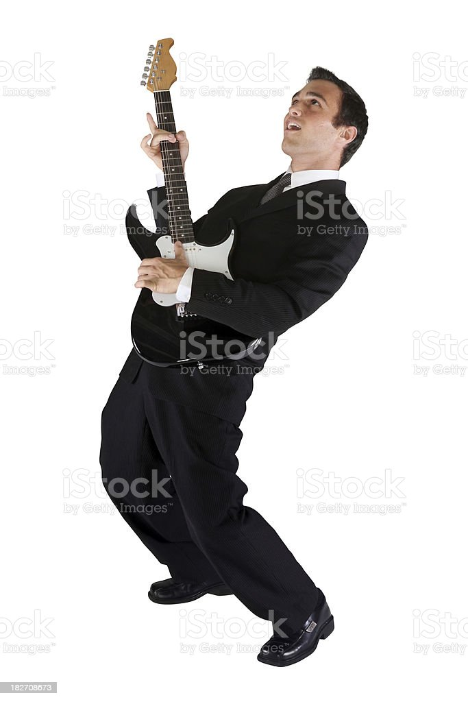 Businessman rocking out with an electric guitar royalty-free stock photo