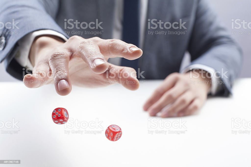 Businessman Rolling Dice stock photo