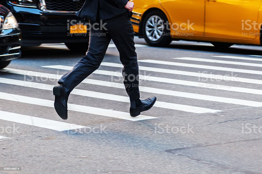 businessman running across the street stock photo