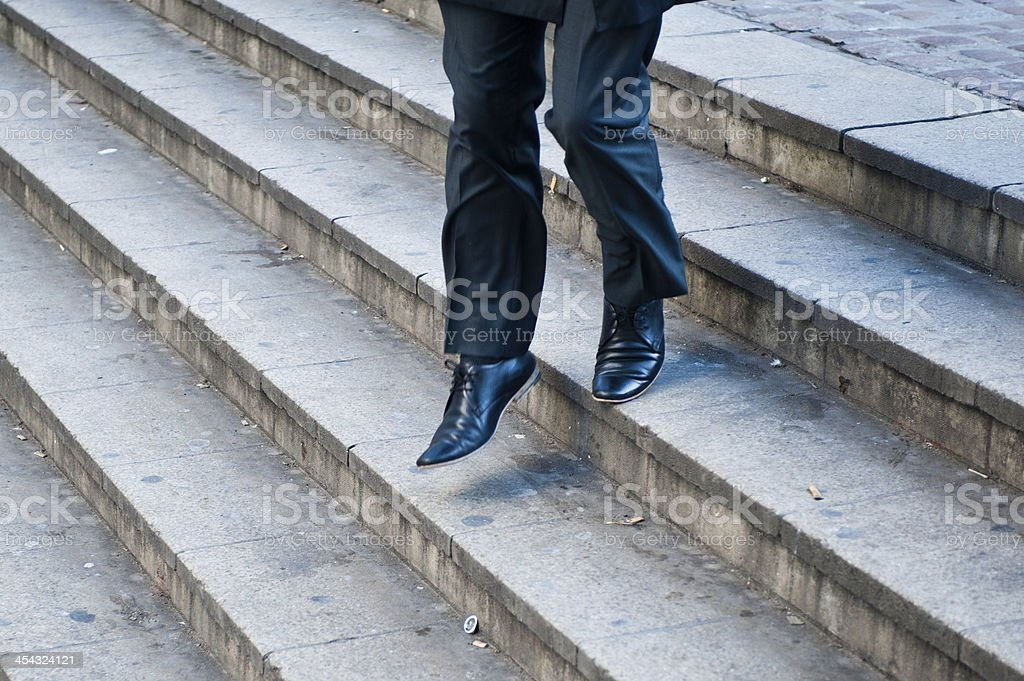Businessman running down stairs royalty-free stock photo