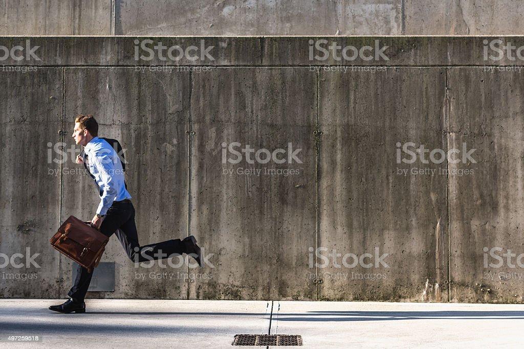 Businessman running fast stock photo