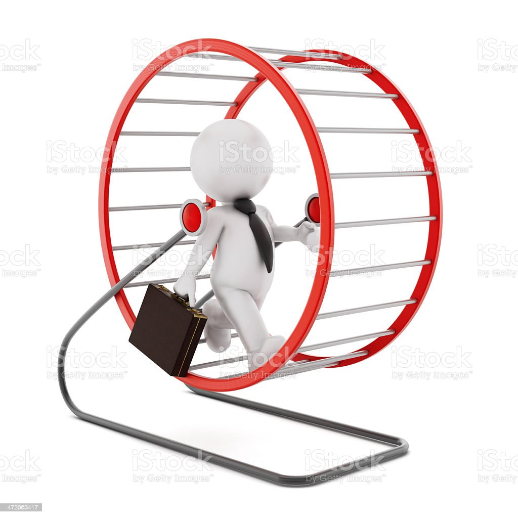 Businessman running in a hamster wheel stock photo