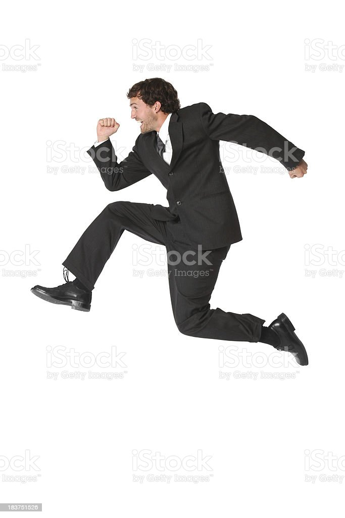 Businessman running in a hurry royalty-free stock photo