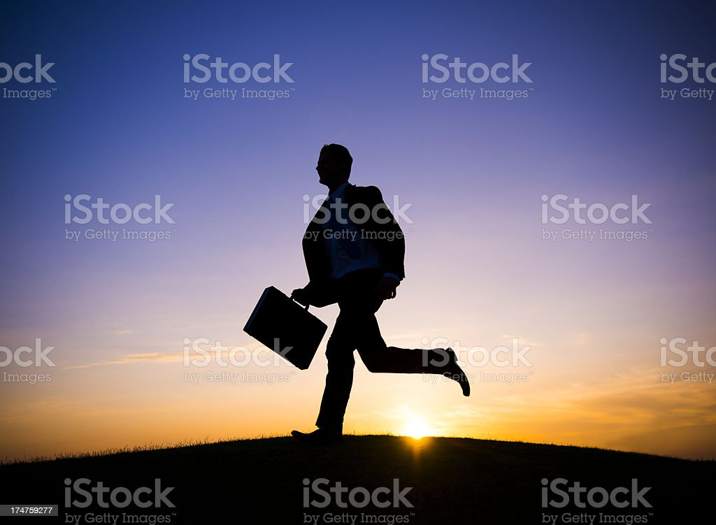 Businessman running in the rush hour royalty-free stock photo