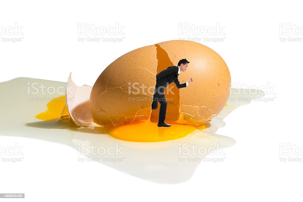 Businessman Running Out From Broken Egg royalty-free stock photo