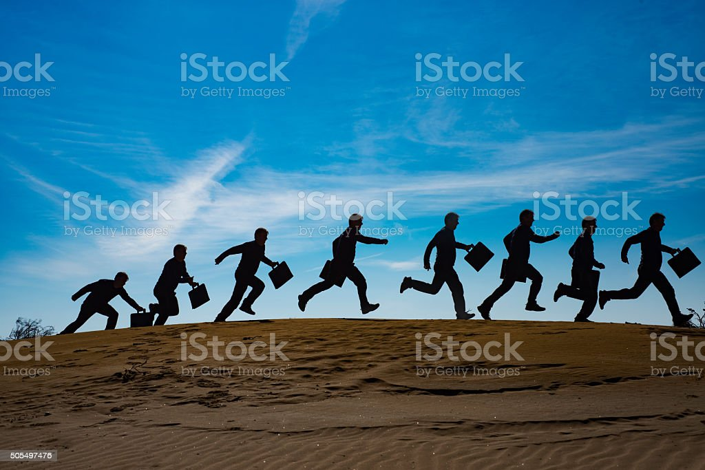 Businessman running to success stock photo