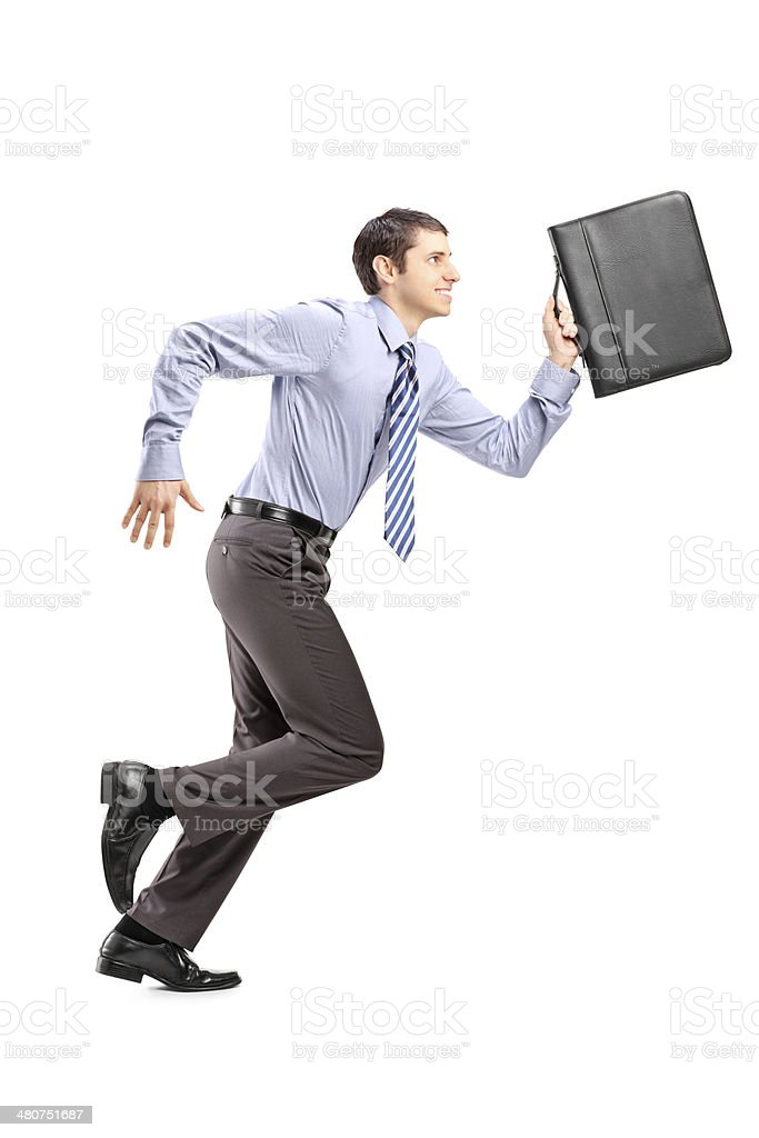 Businessman running with a briefcase stock photo