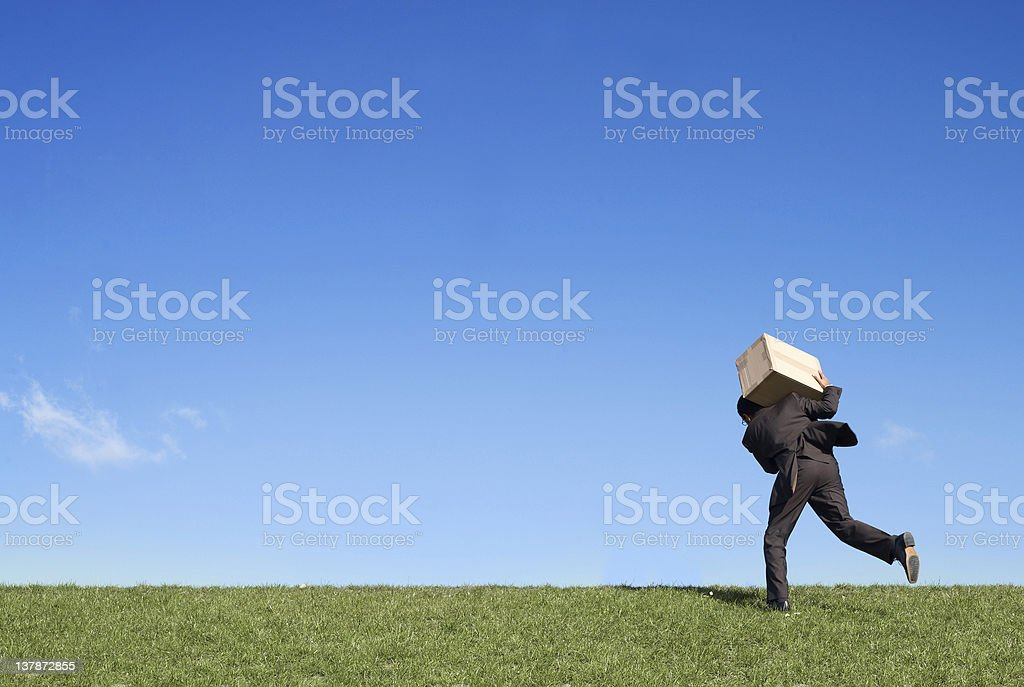 Businessman running with box royalty-free stock photo