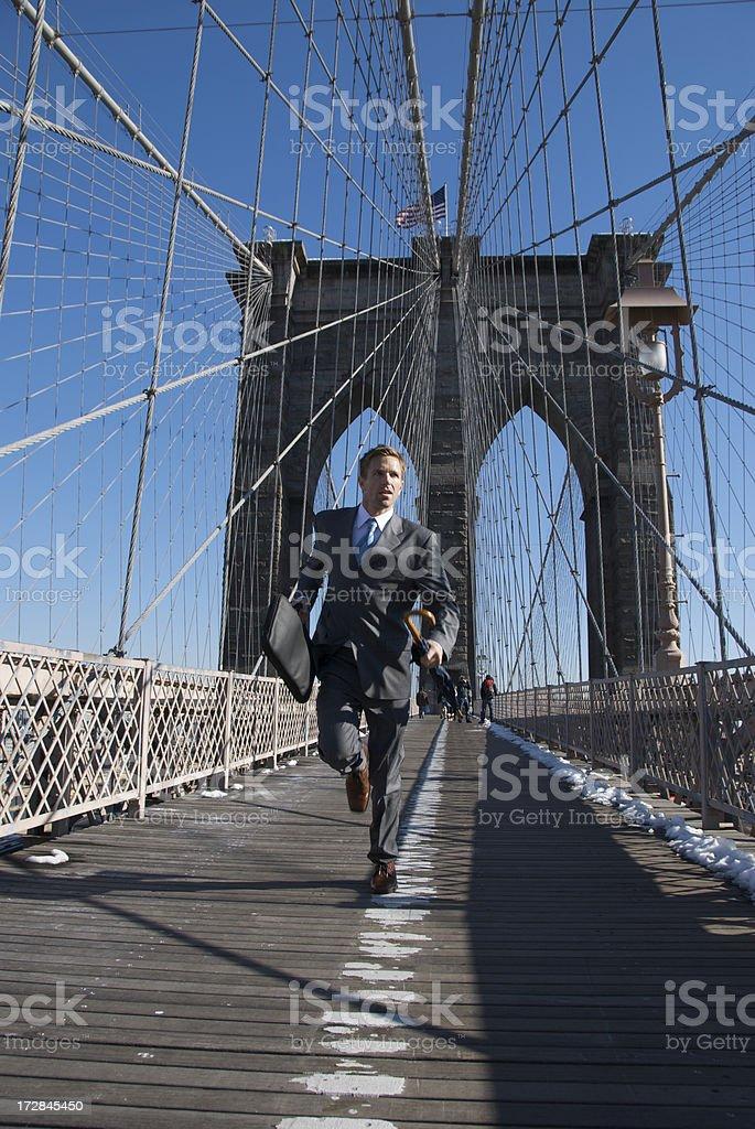 Businessman Runs Across Brooklyn Bridge New York City royalty-free stock photo