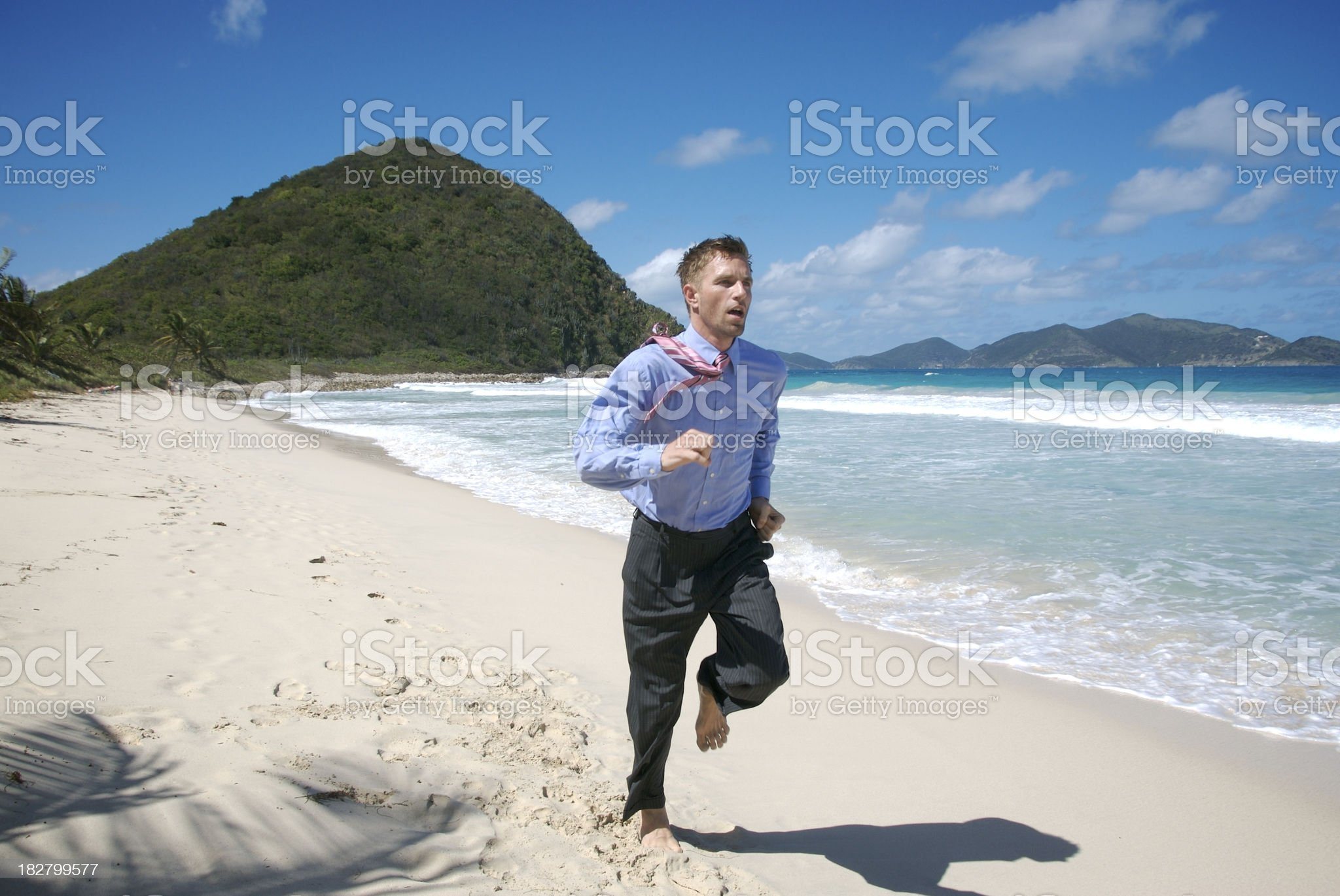 Businessman Runs Along Deserted Tropical Beach royalty-free stock photo
