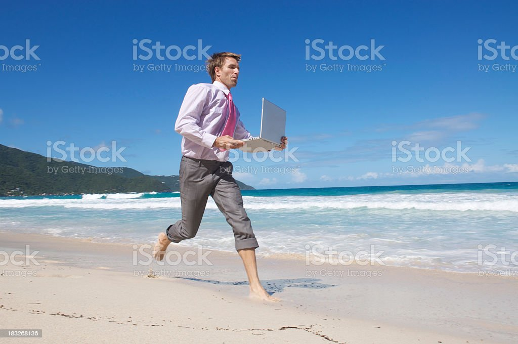 Businessman Rushes Across Beach w Laptop royalty-free stock photo