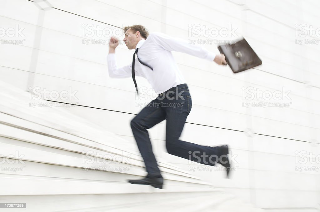 Businessman Rushes Running Up Steps in a Blur royalty-free stock photo