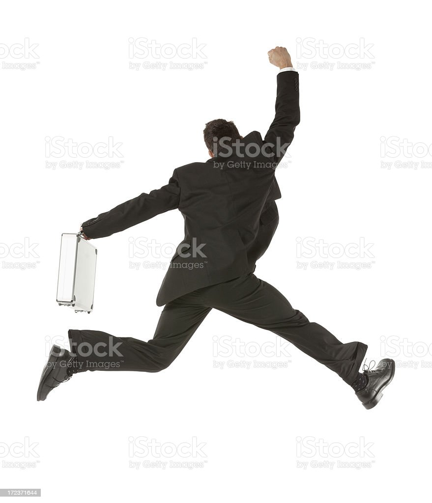 Businessman rushing with briefcase royalty-free stock photo