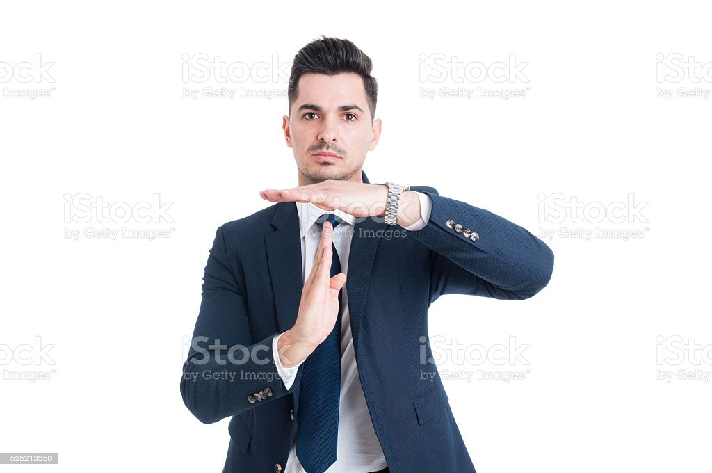 Businessman salesman or broker making timeout gesture stock photo
