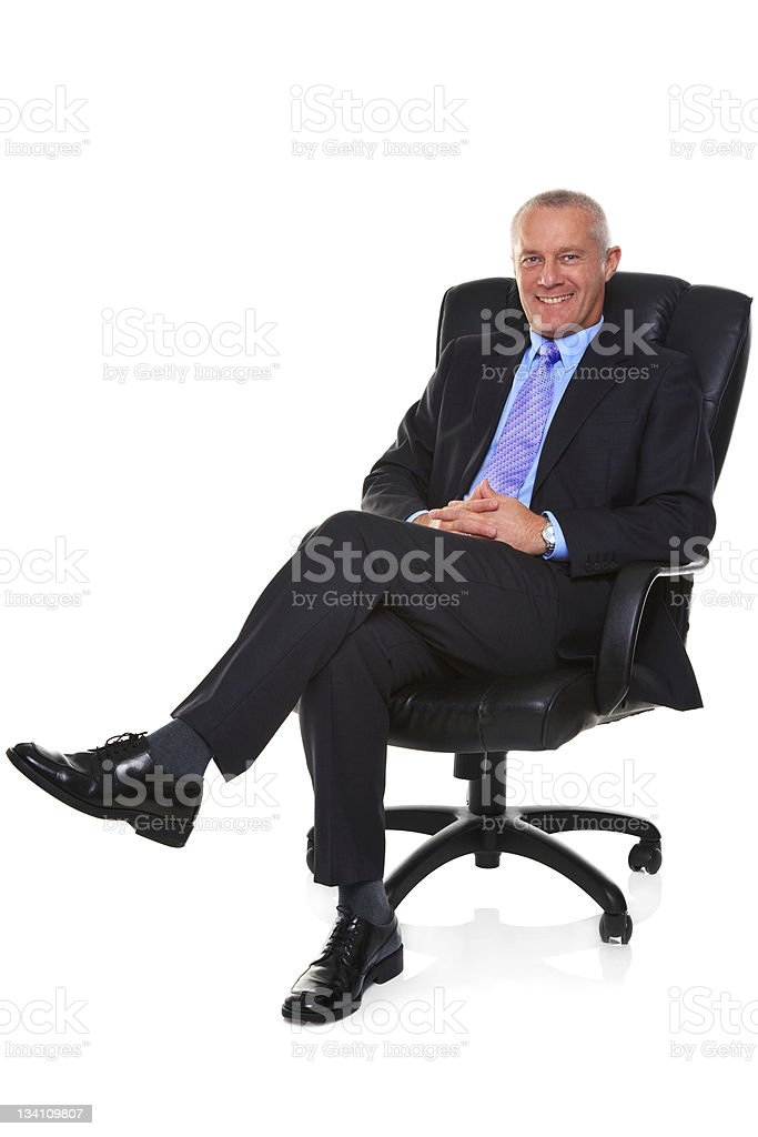 Businessman sat in a leather chair. stock photo