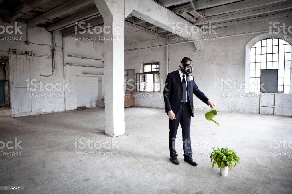 Businessman saving the planet stock photo