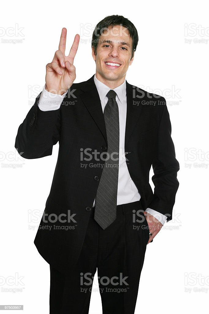 Businessman saying 'peace' stock photo