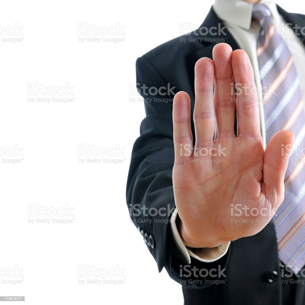 Businessman saying STOP, close-up of man's hand, hold on gesture royalty-free stock photo