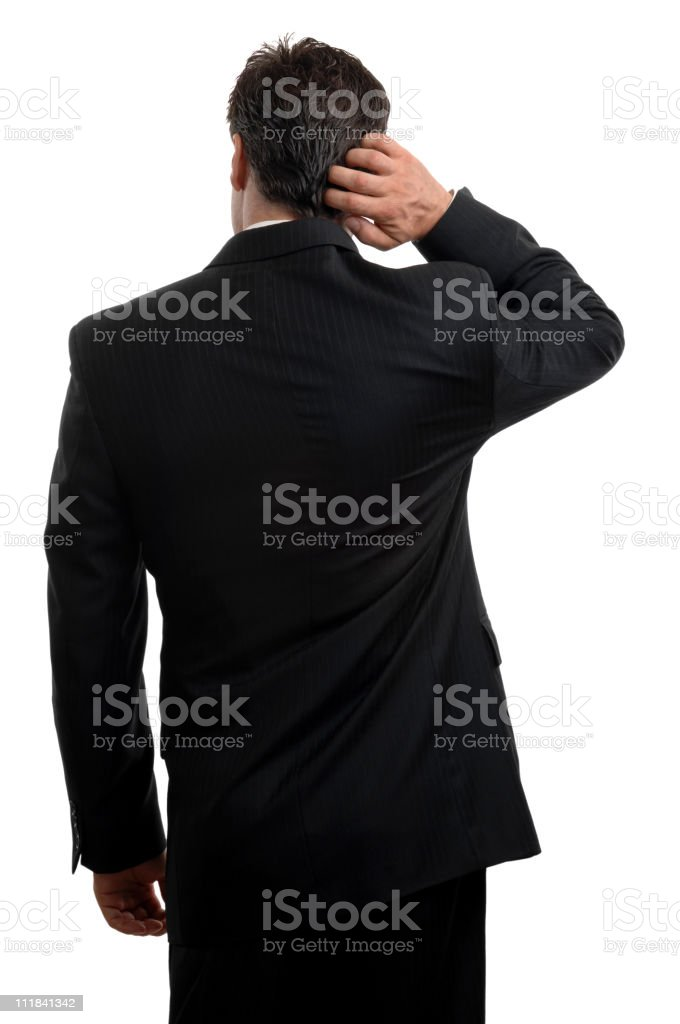 Businessman Scratching Head from Behind Isolated on White Background royalty-free stock photo