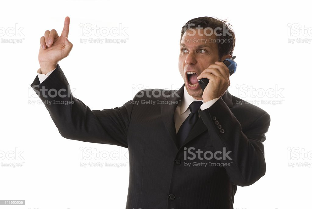 Businessman Screams into Telephone while Gesturing Isolated on White Background royalty-free stock photo