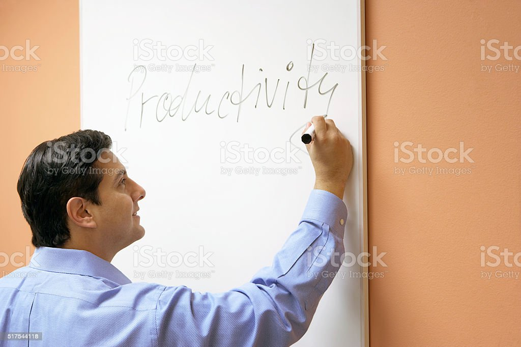 Businessman scribbling on a whiteboard stock photo