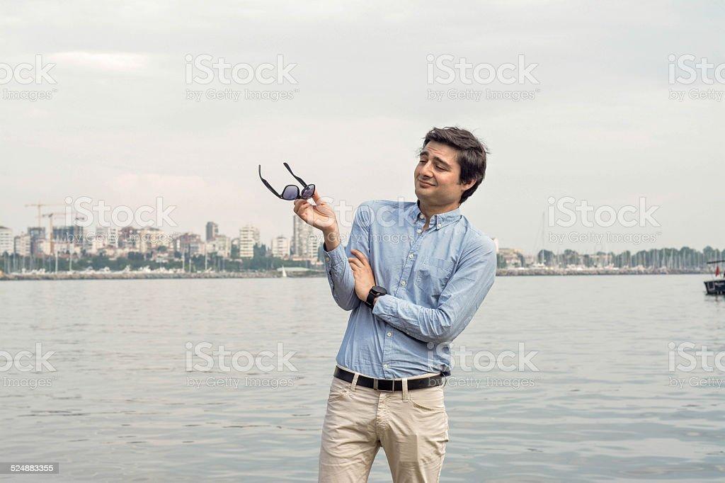 Businessman sea background concept: Making-fun-off facial espression stock photo