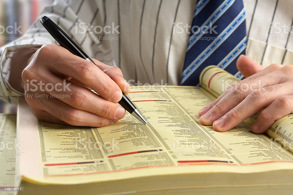 Businessman searching in yellow pages stock photo