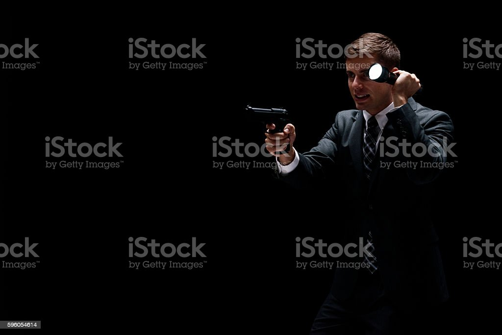 Businessman searching with flash light stock photo