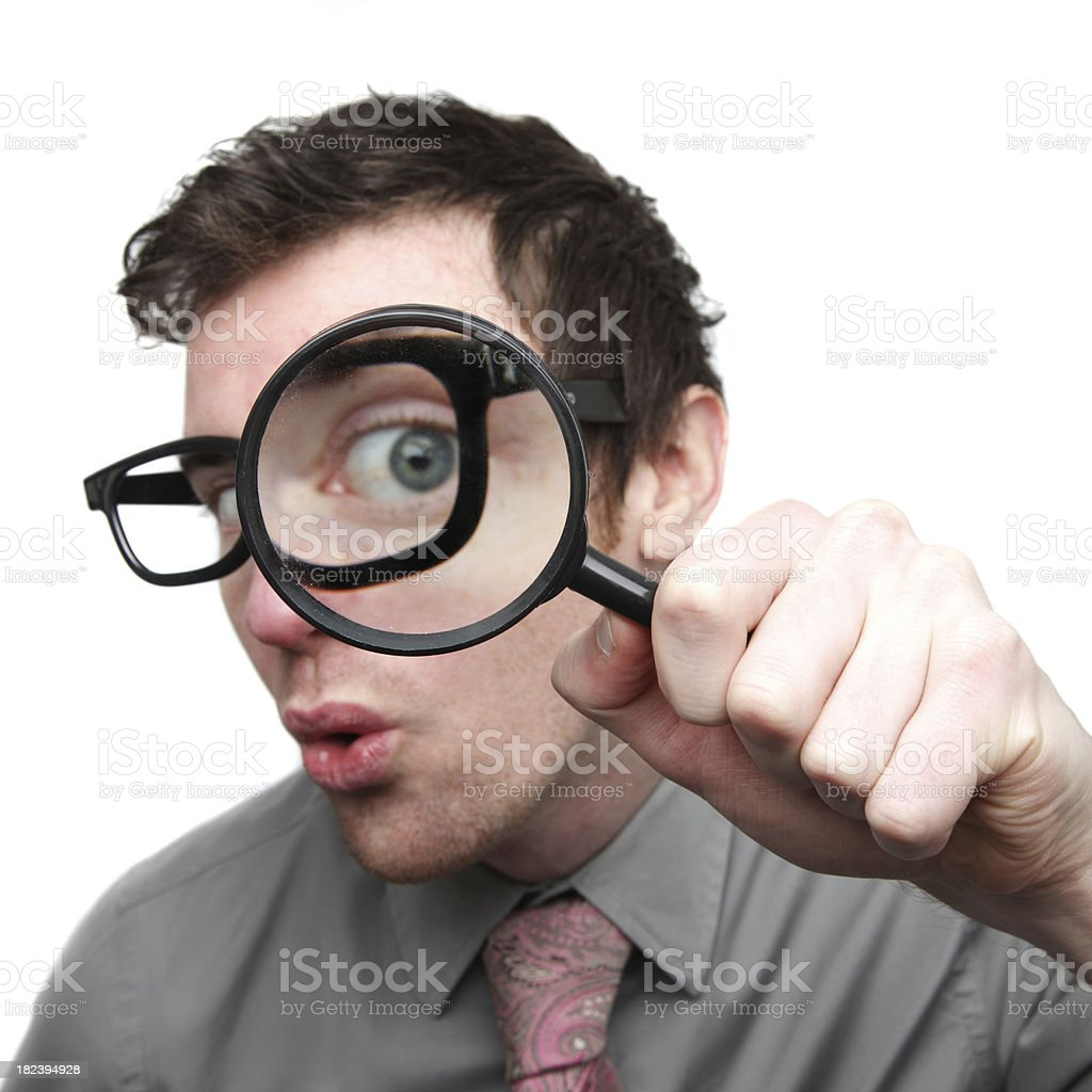Businessman searching with magnifying glass royalty-free stock photo