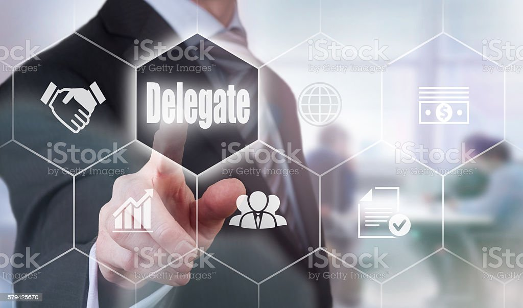 Businessman selecting a Delegate Concept button stock photo