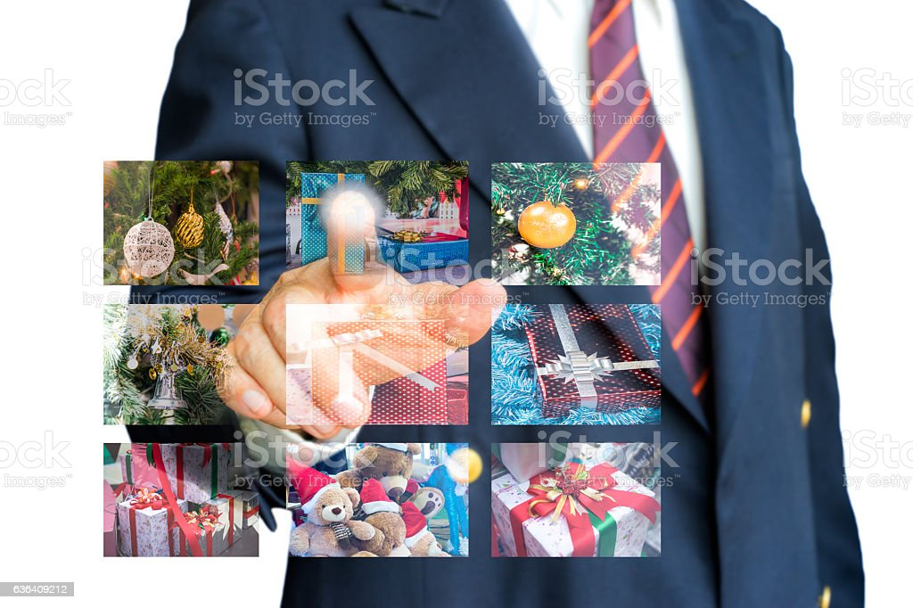 Businessman selecting a festival gift stock photo