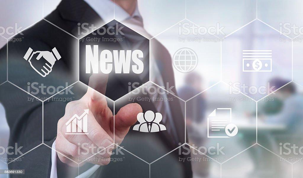 Businessman selecting a News Concept button stock photo