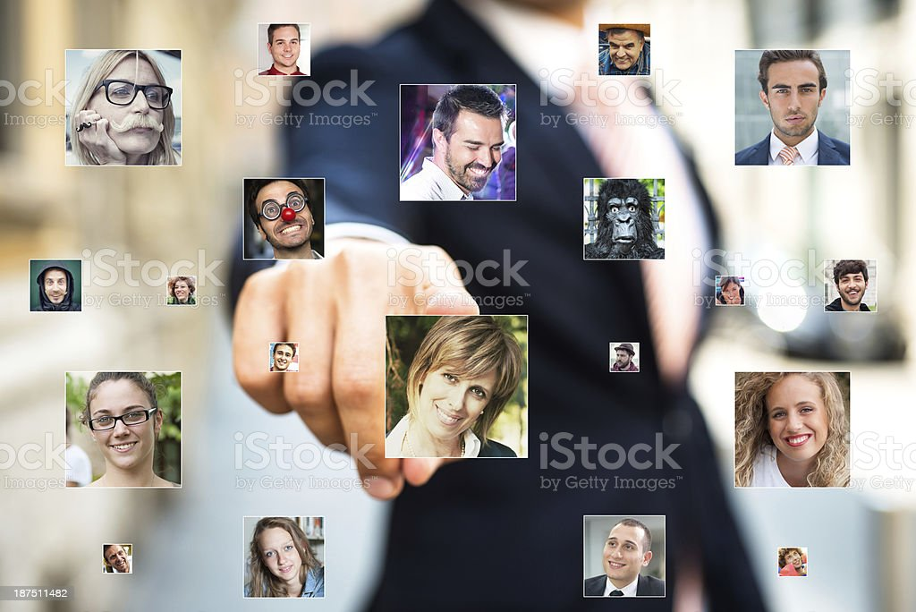 Businessman selecting a person's headshot royalty-free stock photo