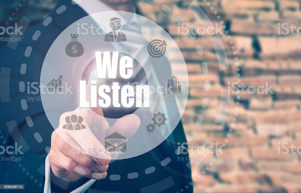 Businessman selecting a We Listen Concept button stock photo