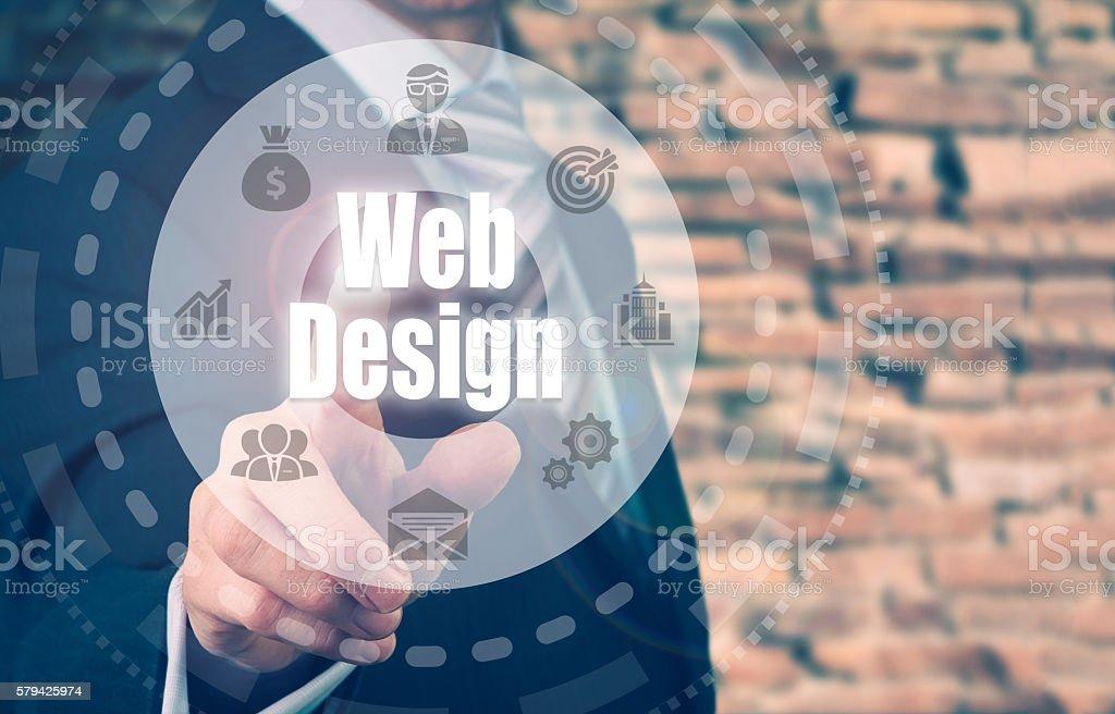 Businessman selecting a Web Design Concept button stock photo