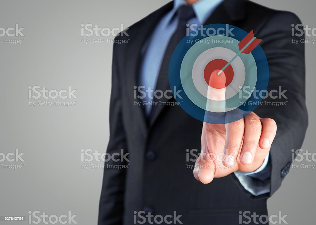 Businessman selecting dartboard button on virtual screen stock photo