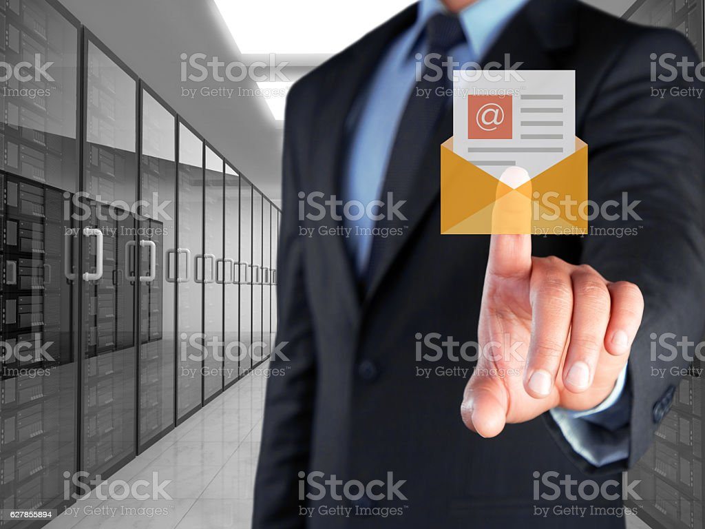 Businessman selecting mail button on virtual screen stock photo