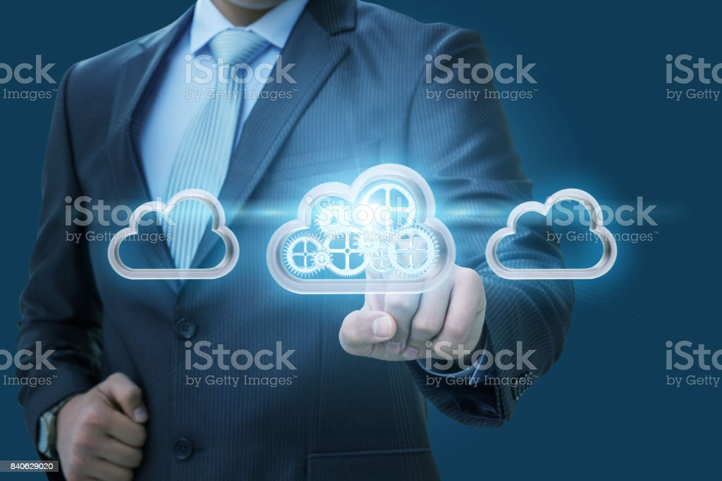 Businessman selects a data cloud . stock photo