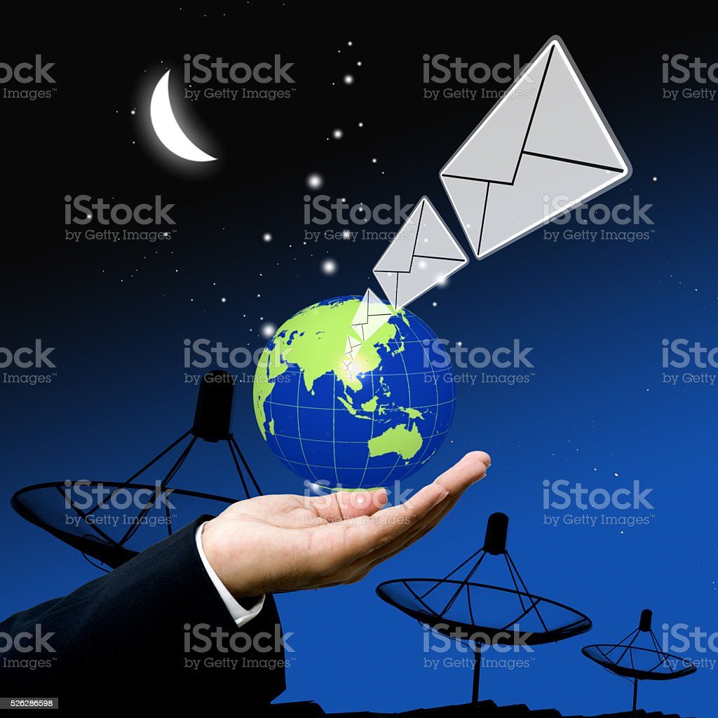 Businessman send email at night stock photo