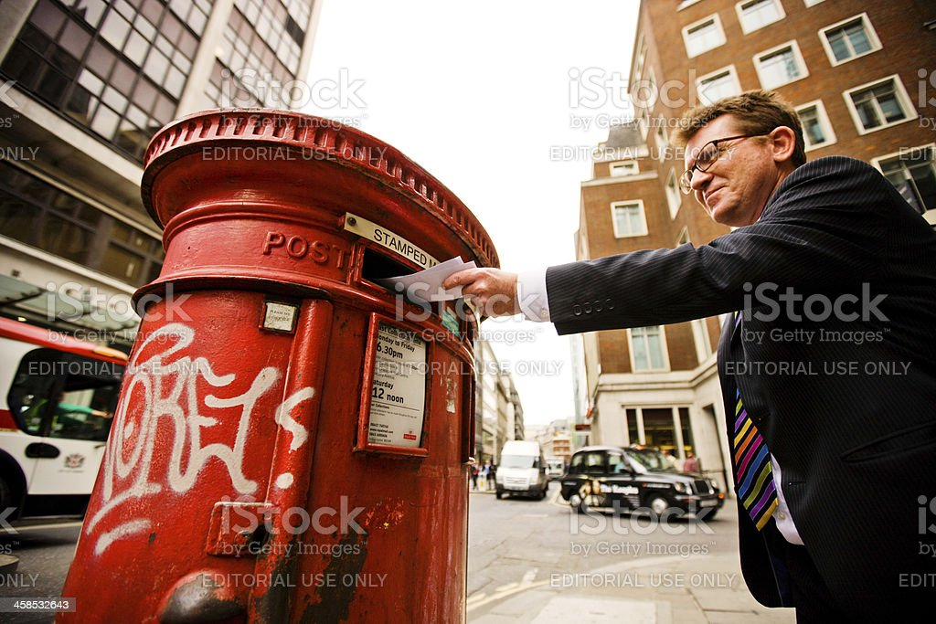 Businessman Sending Mail on one of the London Streets stock photo
