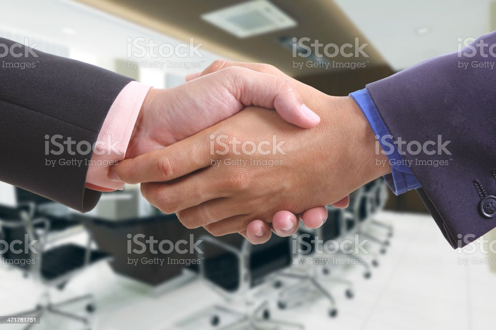 businessman shaking hands royalty-free stock photo